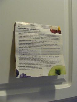 Canning instruction sheet taped to cabinet