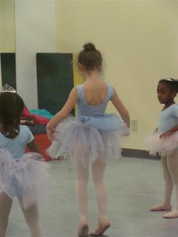 First ballet class trying on tutus