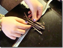 laying the bundle of twigs to tie