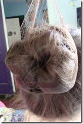 put hair net on bun