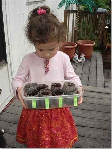 ella with paper pots
